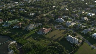 AX0032_156 - 5K stock footage aerial video of flying by a residential neighborhood, Stuart, Florida