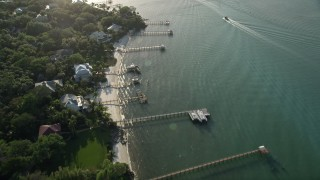 AX0032_157 - 5K stock footage aerial video of flying by docks along the shore, Saint Lucie Inlet, Stuart, Florida