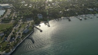 AX0032_158 - 5K stock footage aerial video of approaching house by Sandspirit Park, Stuart, Florida