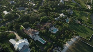 AX0032_159 - 5K stock footage aerial video of flying over homes on the shore, Saint Lucie Inlet, Stuart, Florida