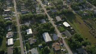 AX0032_161 - 5K stock footage aerial video of flying over a residential neighborhood, Stuart, Florida