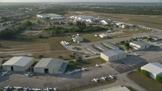 AX0032_163 - 5K stock footage aerial video of flying over Witham Field Airport, revealing jets on tarmac, Stuart, Florida