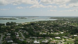 AX0033_002 - 5K stock footage aerial video of flying over waterfront neighborhood toward an inlet, Stuart, Florida