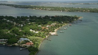 AX0033_003 - 5K stock footage aerial video of fly by waterfront community and docks on an inlet, Stuart, Florida