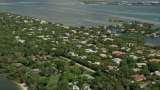 AX0033_004 - 5K stock footage aerial video of flying over riverfront community by the Indian River, Stuart, Florida