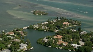 AX0033_005 - 5K stock footage aerial video fly over homes on small islands on Indian River, Stuart, Florida