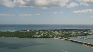 AX0033_008 - 5K stock footage aerial video of flying by Hutchinson Island, Stuart, Florida