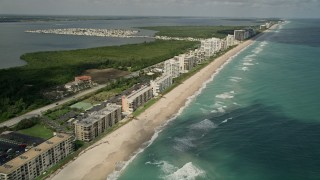 AX0033_012 - 5K stock footage aerial video of beachside apartment buildings and blue ocean waters, Jensen Beach, Florida