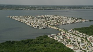 AX0033_013 - 5K stock footage aerial video of houses on a waterfront island community, Nettles Island, Jensen Beach, Florida