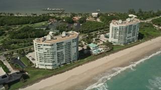 AX0033_015 - 5K stock footage aerial video of a beachside condominium complex, Jensen Beach, Florida
