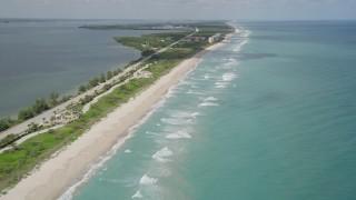 AX0033_016 - 5K stock footage aerial video of following the beach along the coast, Jensen Beach, Florida