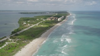AX0033_017 - 5K stock footage aerial video of following the beach and approach waterfront villas, Jensen Beach, Florida