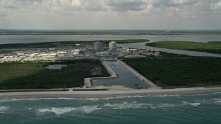 AX0033_021 - 5K stock footage aerial video fly away from St. Lucie Nuclear Power Plant over the ocean, Florida
