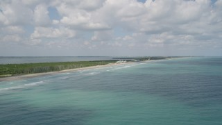 AX0033_024 - 5K stock footage aerial video fly over blue waters toward the coast, Fort Pierce, Florida