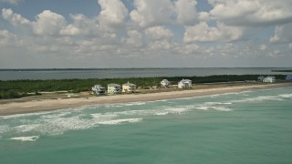 AX0033_025 - 5K stock footage aerial video of beachfront homes along the blue ocean waters, Fort Pierce, Florida