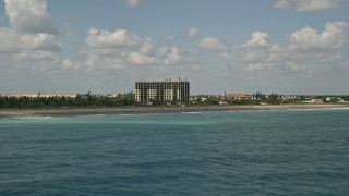 AX0033_039 - 5K stock footage aerial video of flying by a beachfront apartment building, Fort Pierce, Florida