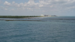 AX0033_040 - 5K stock footage aerial video of breakwaters along an inlet, Fort Pierce, Florida