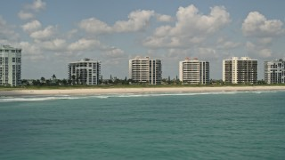 AX0033_043 - 5K stock footage aerial video fly by beachfront apartment buildings, Fort Pierce, Florida