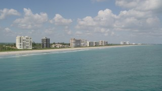 AX0033_045 - 5K stock footage aerial video fly by beachfront apartment buildings, Fort Pierce, Florida