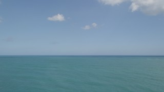 AX0033_048 - 5K stock footage aerial video of the ocean seen from Fort Pierce, Florida