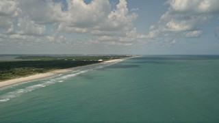AX0033_050 - 5K stock footage aerial video of approaching coastal beach and blue waters, Vero Beach, Florida