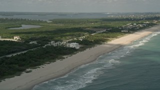 AX0033_051 - 5K stock footage aerial video of approaching a condominium complex by the beach, Vero Beach, Florida