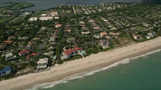 AX0033_057 - 5K stock footage aerial video fly away from a residential beachside neighborhood, Vero Beach, Florida