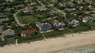 AX0033_058 - 5K stock footage aerial video of orbiting away from beachside mansions, Vero Beach, Florida
