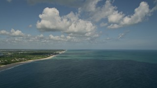 AX0033_059 - 5K stock footage aerial video of approaching the beach from high above the ocean, Vero Beach, Florida