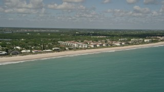 AX0033_064 - 5K stock footage aerial video of flying by a beach side condominium complex, Vero Beach, Florida