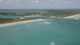AX0033_065 - 5K stock footage aerial video of flying by a bridge spanning an inlet with crystal blue waters, Vero Beach, Florida