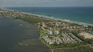AX0033_068 - 5K stock footage aerial video of approaching docks and residential neighborhood on the coast, Melbourne Beach