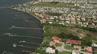 AX0033_070 - 5K stock footage aerial video tilt up from riverside residential neighborhood revealing a mobile park, Melbourne Beach