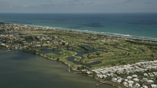 AX0033_071 - 5K stock footage aerial video of a golf course by the river, Melbourne Beach, Florida