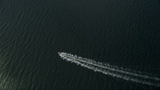 AX0033_073 - 5K stock footage aerial video of tracking a speedboat in the river, Melbourne Beach, Florida