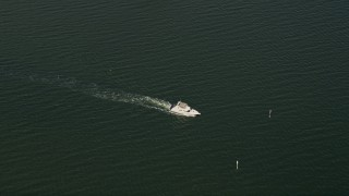 AX0033_075 - 5K stock footage aerial video of tracking a fishing boat on the river, Melbourne Beach, Florida