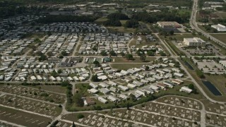 AX0033_080 - 5K stock footage aerial video of orbiting a mobile home park, Melbourne, Florida