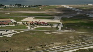 AX0034_002 - 5K stock footage aerial video flyby buildings at Patrick Air Force Base, Central Florida