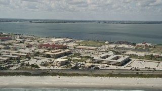AX0034_006 - 5K stock footage aerial video of flying by the buildings at Patrick Air Force Base, Florida