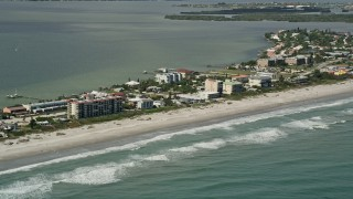 AX0034_008 - 5K stock footage aerial video of the beach with condominiums, Cocoa Beach, Florida