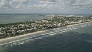 AX0034_011 - 5K stock footage aerial video fly over ocean water along the coast, Cocoa Beach, Florida