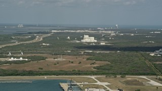 AX0034_015 - 5K stock footage aerial video of Cape Canaveral among trees, Florida