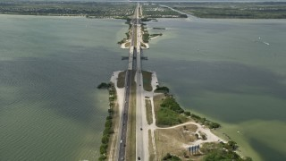 AX0034_021 - 5K stock footage aerial video tilt up from Bennett Causeway revealing Merritt Island, Florida
