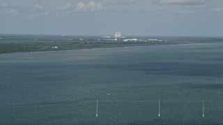 AX0034_022 - 5K stock footage aerial video of Cape Canaveral seen from across Banana River, Florida