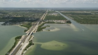 AX0034_023 - 5K stock footage aerial video of following the Bennett Causeway toward Merritt Island, Florida