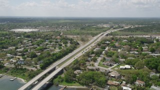 AX0034_027 - 5K stock footage aerial video of approaching an expressway through a residential neighborhood, Cocoa, Florida