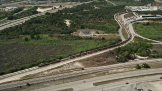 AX0034_028 - 5K stock footage aerial video of approaching a stopped train, Cocoa, Florida