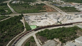 AX0034_029 - 5K aerial stock footage video of approaching a quarry, Cocoa, Florida