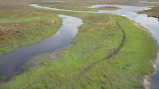 AX0034_044 - 5K stock footage aerial video fly over rivers and marshland, Cocoa, Florida