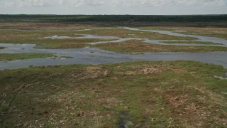 AX0034_048 - 5K stock footage aerial video of panning across rivers and marshland, Cocoa, Florida